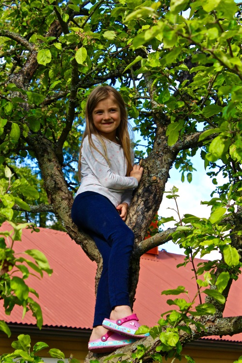 Emma in the tree.
